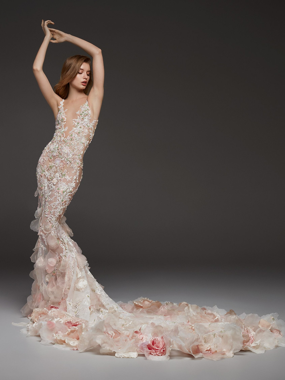 A blush mermaid wedding dress, with flowers and a long train