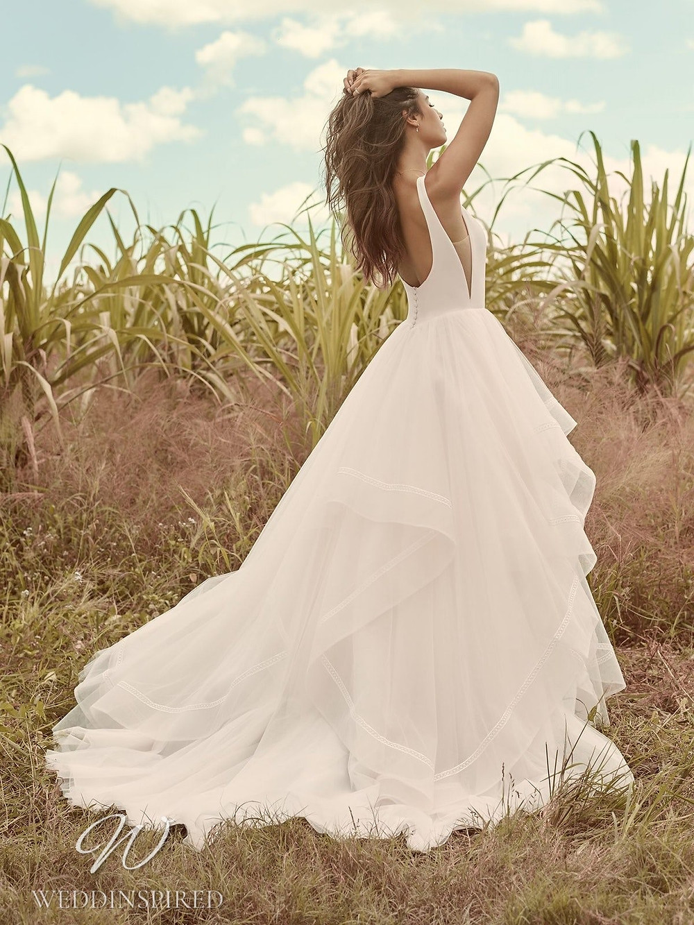 A Rebecca Ingram Spring 2021 tulle A-line wedding dress with straps