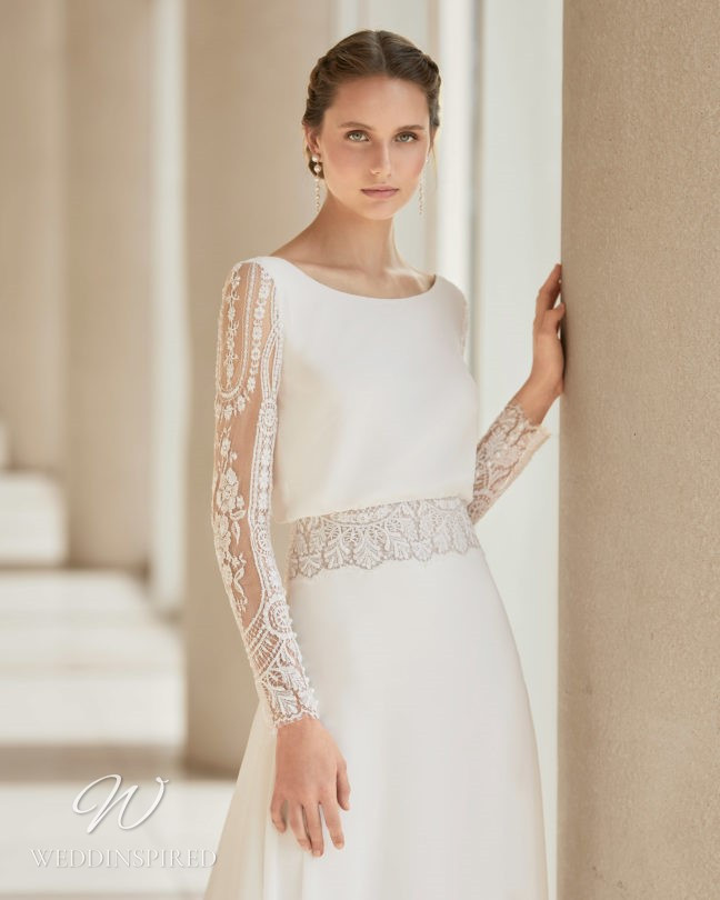 An Aire Barcelona 2021 lace and satin sheath wedding dress with long sleeves