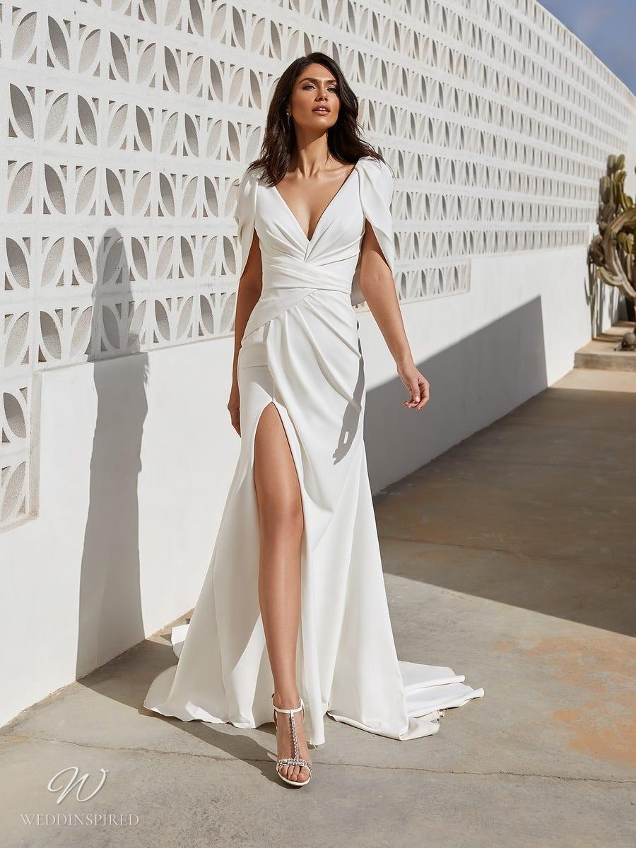 A Pronovias 2021 Grecian style A-line wedding dress with a high slit and a v neckline