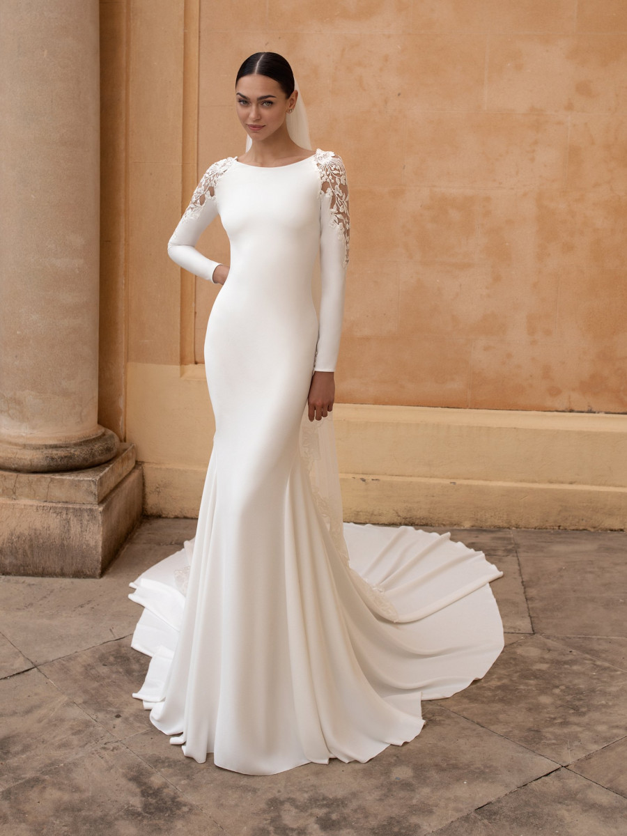 A Pronovias modest mermaid wedding dress with lace and a train