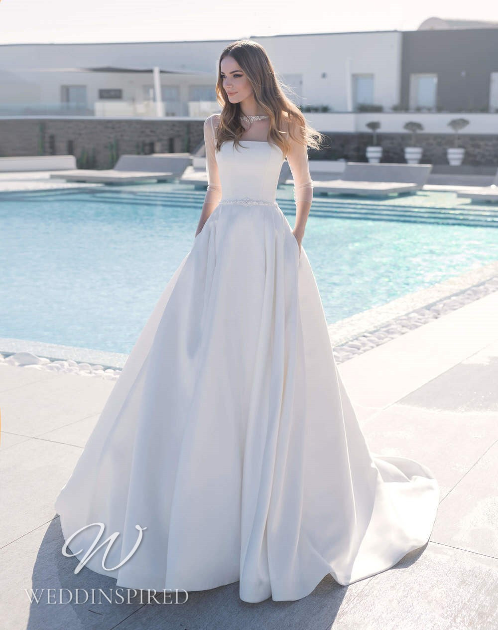 A Blunny 2021 satin A-line wedding dress with long sleeves