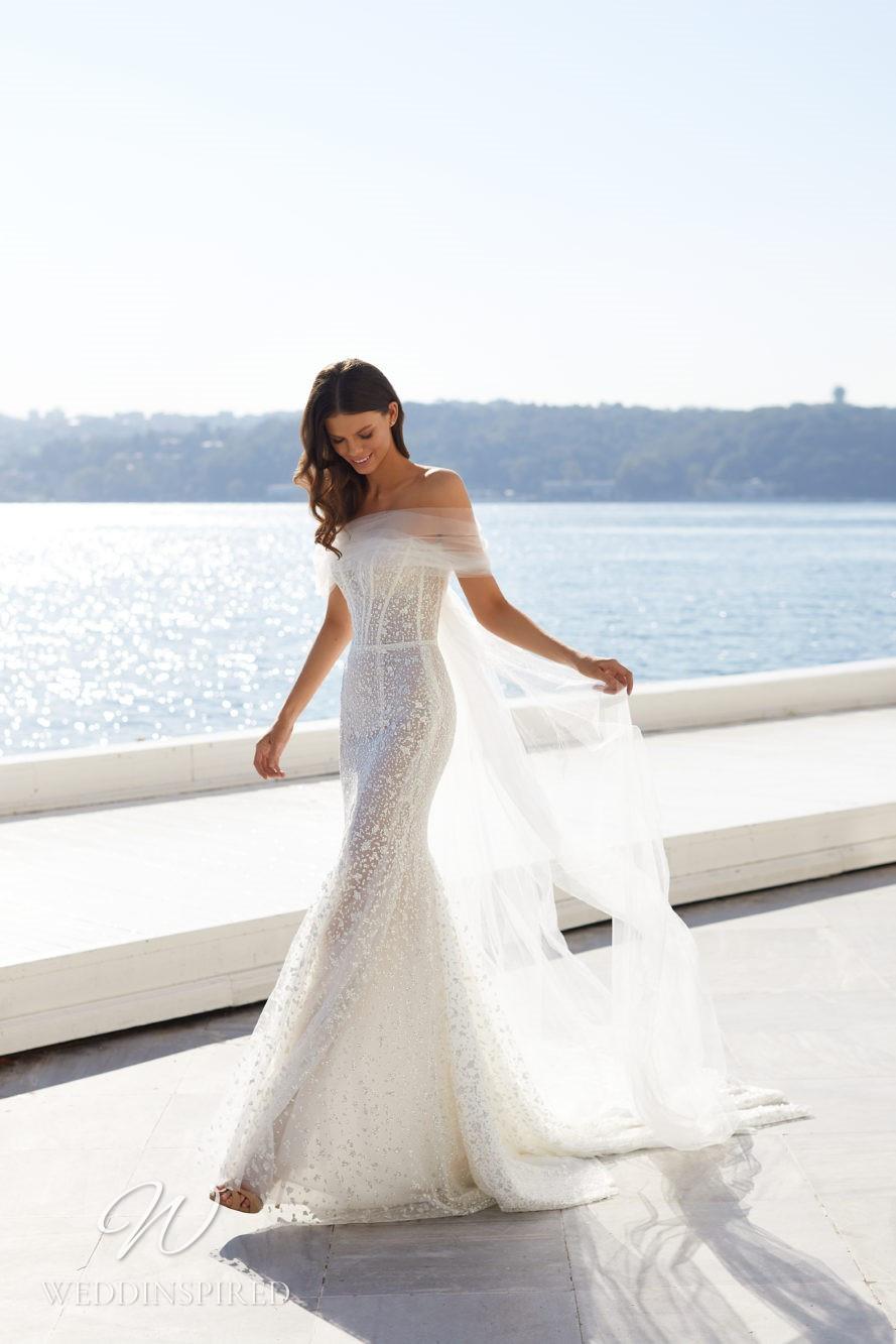 A Milla Nova 2021 sparkly off the shoulder tulle mermaid wedding dress