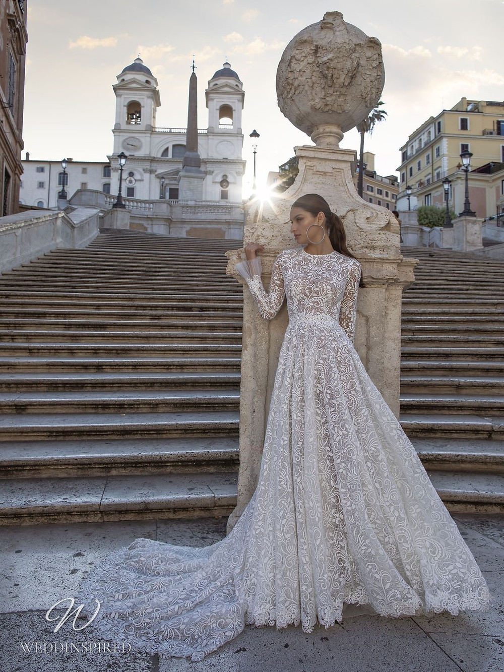 A Pinella Passaro lace A-line wedding dress with long sleeves and a high neck
