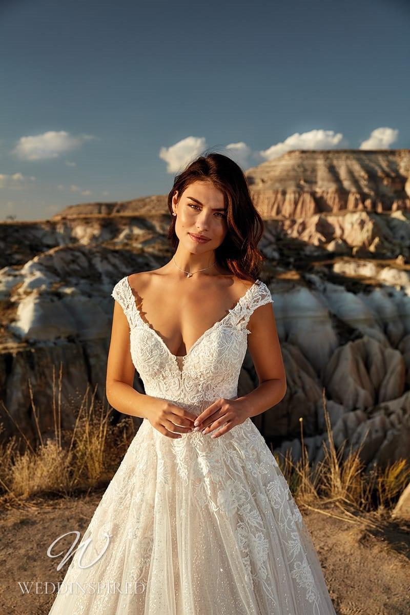 An Eddy K 2021 lace off the shoulder blush A-line wedding dress