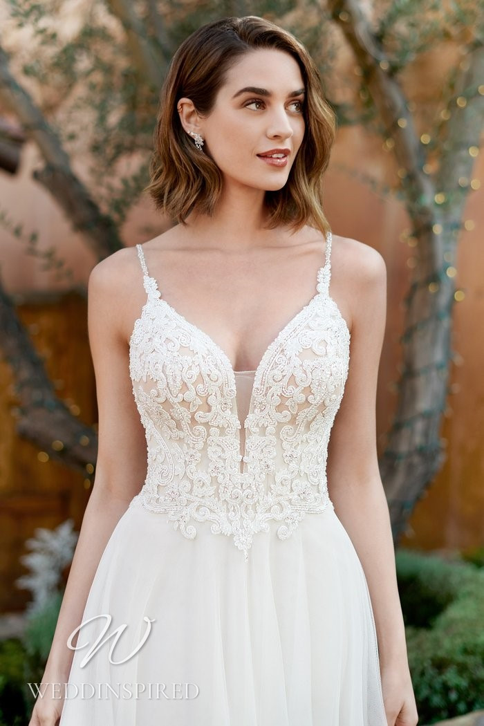 A Kenneth Winston 2021 lace and chiffon A-line wedding dress with a v neck