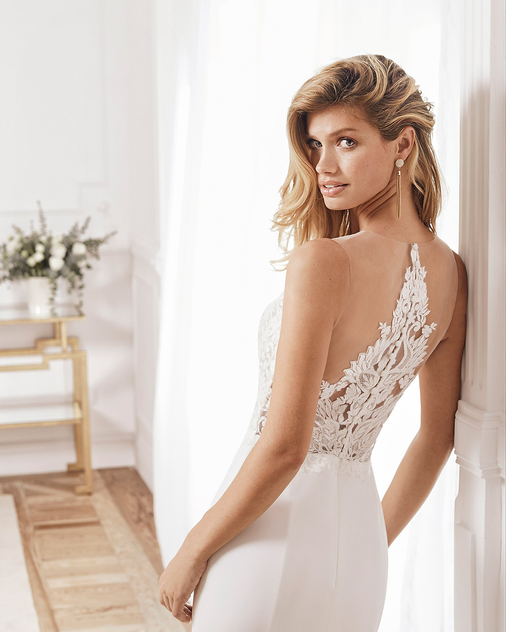 An Aire Barcelona 2020 lace and crepe mermaid fit and flare wedding dress with an illusion neckline