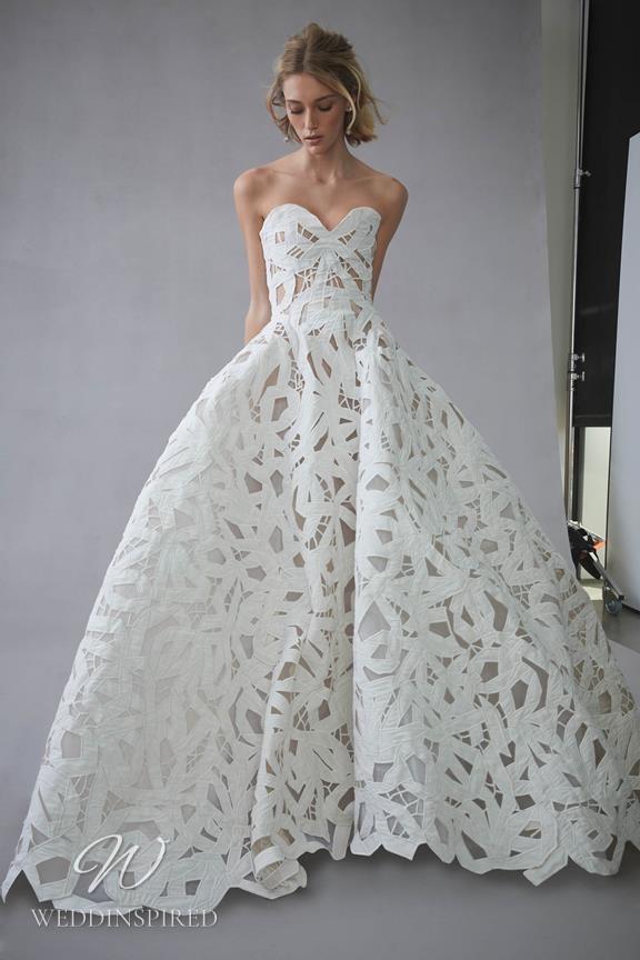 An Oscar de la Renta 2022 strapless lace ball gown wedding dress