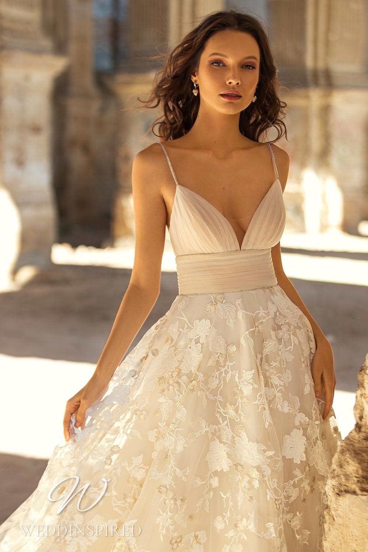 An Eva Lendel 2021 ivory lace A-line wedding dress