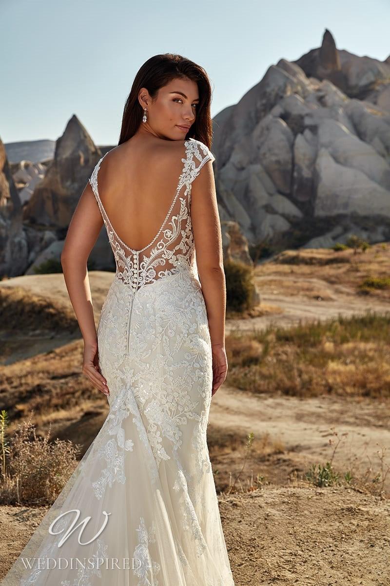 An Eddy K 2021 lace mermaid wedding dress with a low back