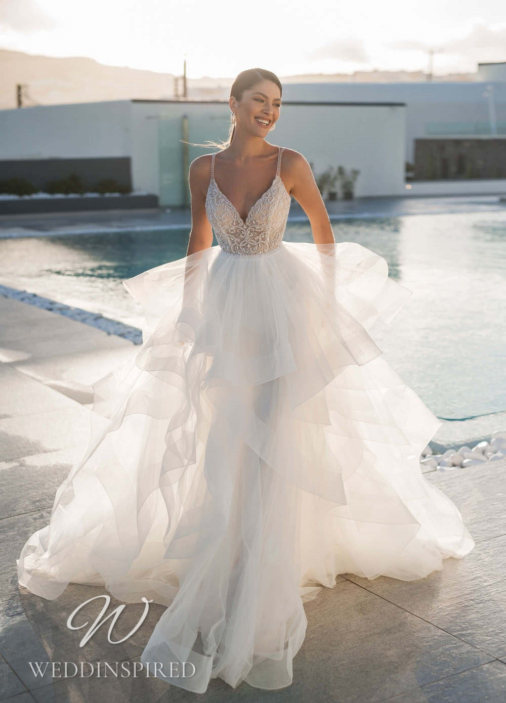 A Blunny 2021 lace and tulle A-line wedding dress with a ruffle skirt