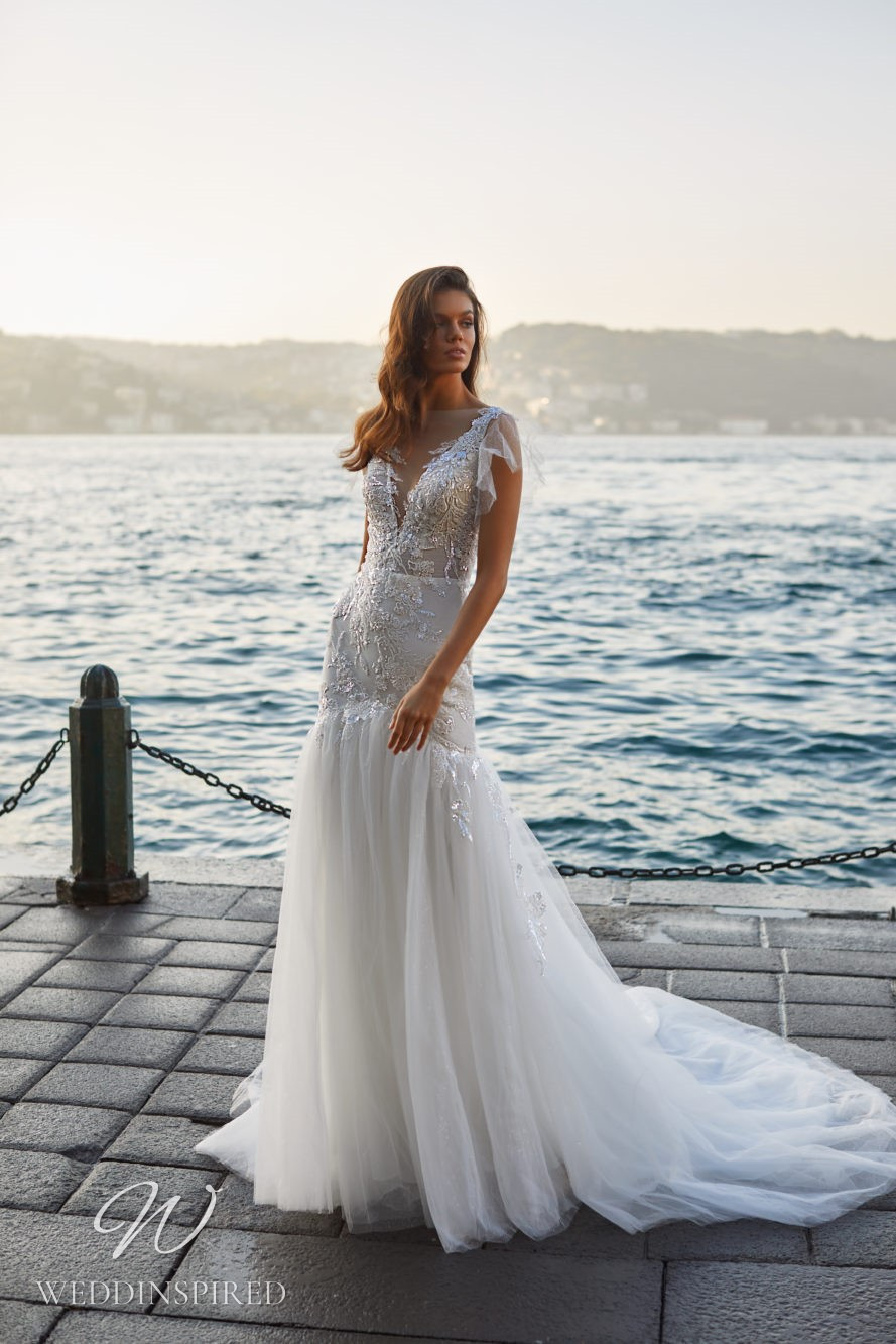 A Milla Nova 2021 silver lace and tulle mermaid wedding dress with straps and a v neck