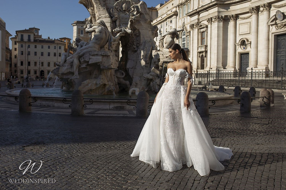A Pinella Passaro lace off the shoulder A-line wedding dress with a detachable skirt