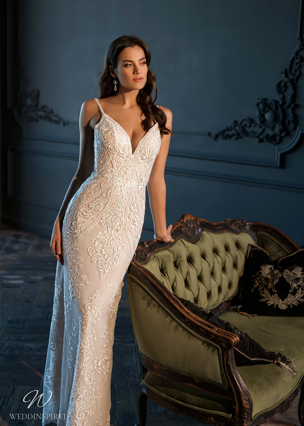A Naviblue Bridal 2021 ivory lace mermaid fit and flare wedding dress with straps
