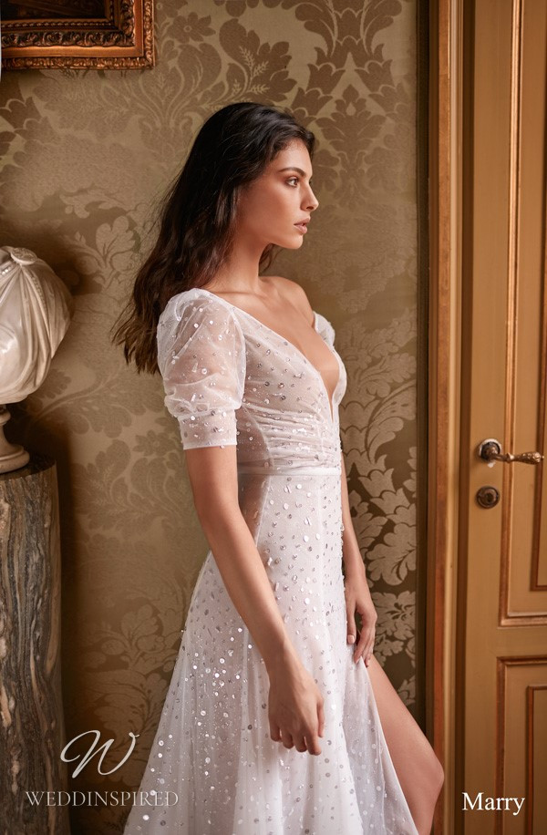 A Gali Karten off the shoulder sparkly flowy A-line wedding dress