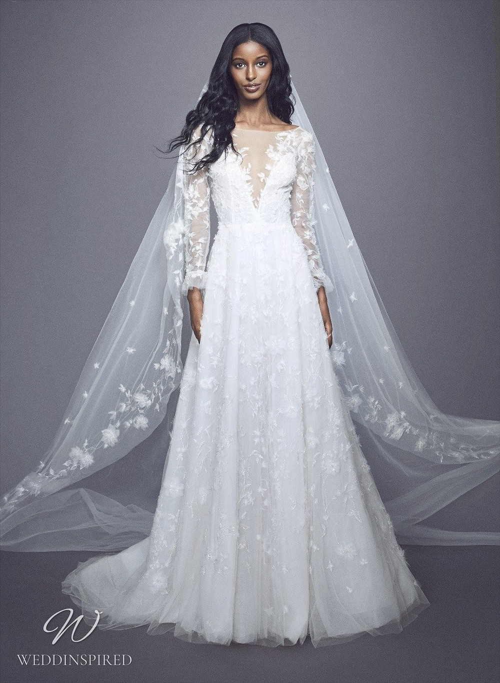A Marchesa Fall 2021 lace and tulle A-line wedding dress with long illusion sleeves