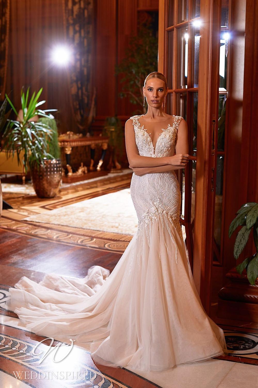 A Pollardi 2021 blush lace and tulle mermaid wedding dress
