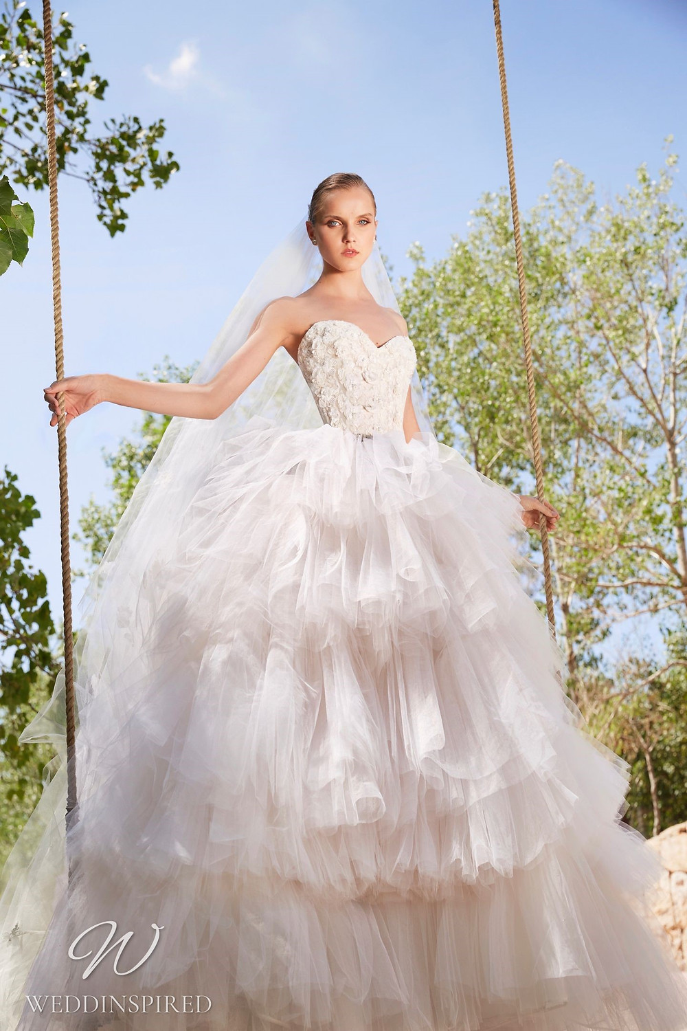 An Elie Saab Spring 2021 strapless lace and tulle ball gown wedding dress with a ruffle skirt