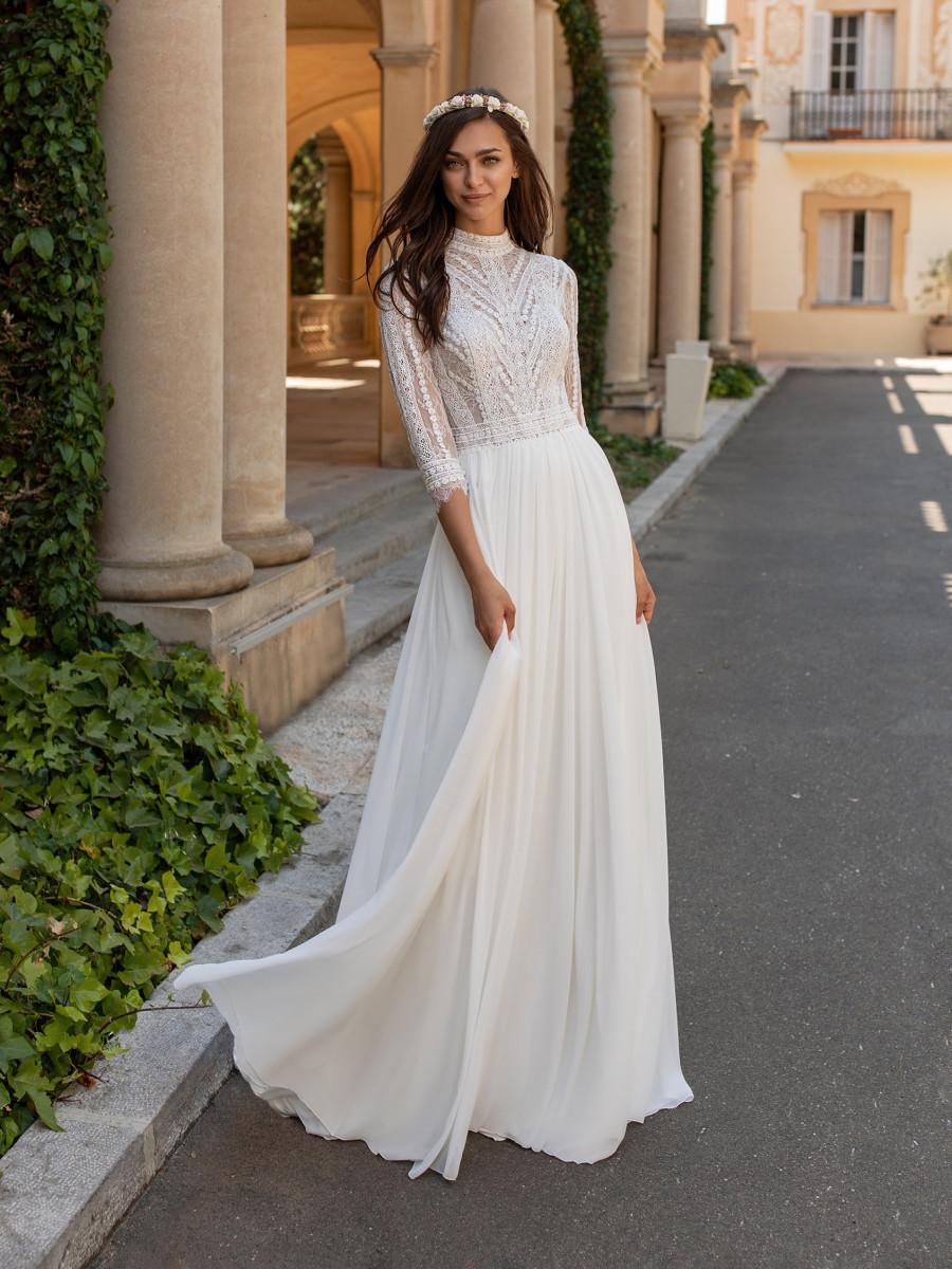 A Pronovias modest lace, 3/4 sleeve A-line wedding dress, with chiffon skirt