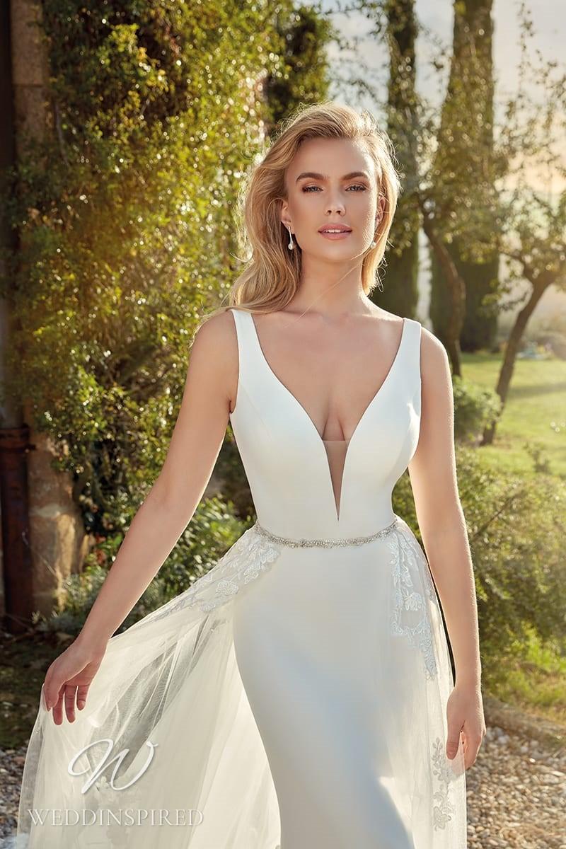 An Eddy K 2021 simple satin mermaid wedding dress with a lace detachable skirt