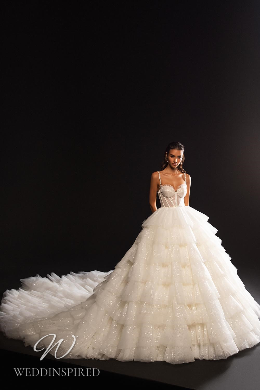 A WONÁ Concept 2021 tulle princess wedding dress with a ruffle skirt