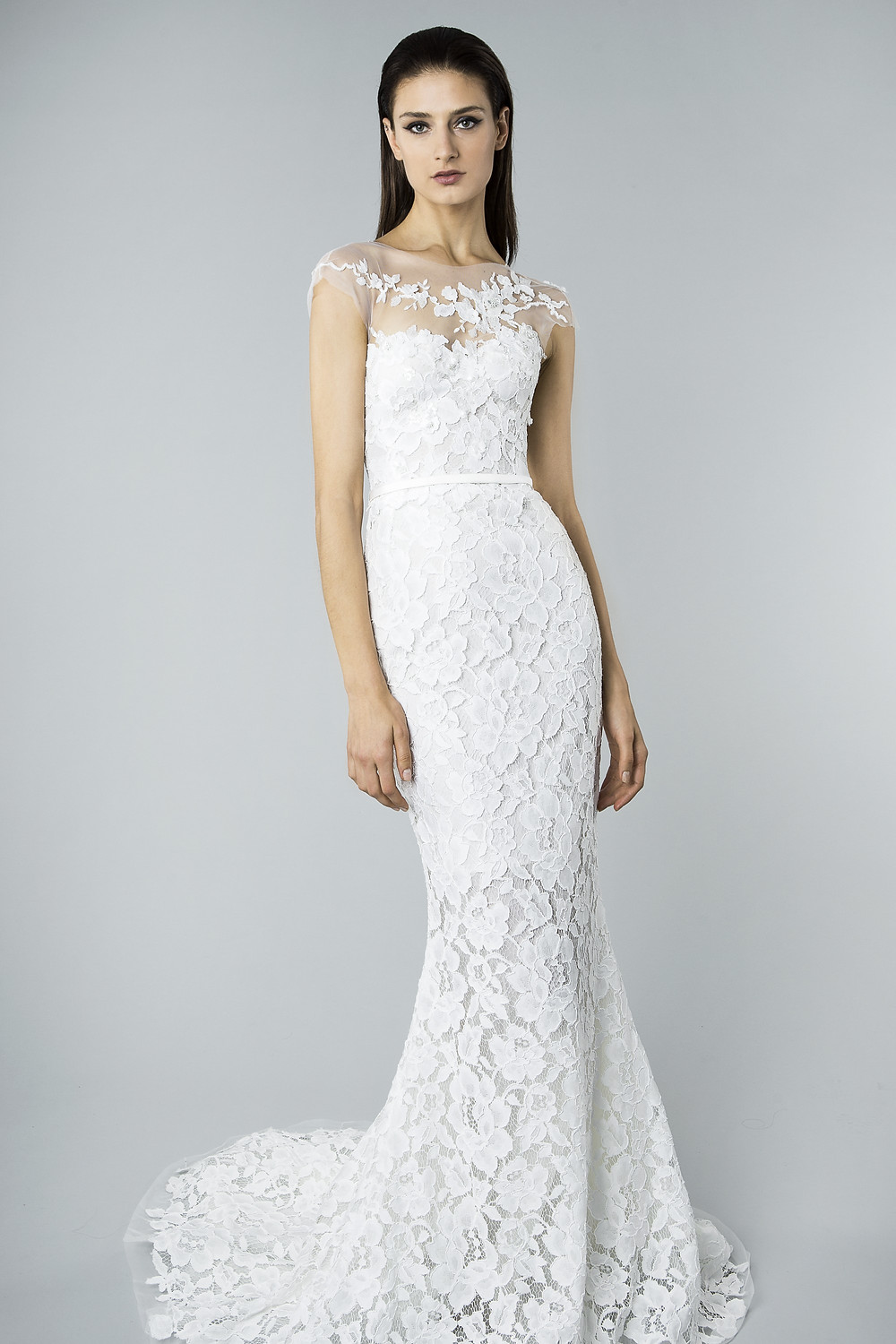 A Mira Zwillinger lace and mesh mermaid fit and flare wedding dress