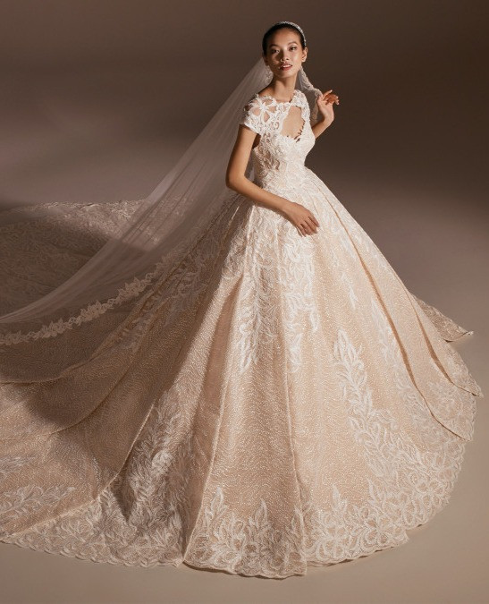 A Pronovias blush peach romantic lace ball gown wedding dress