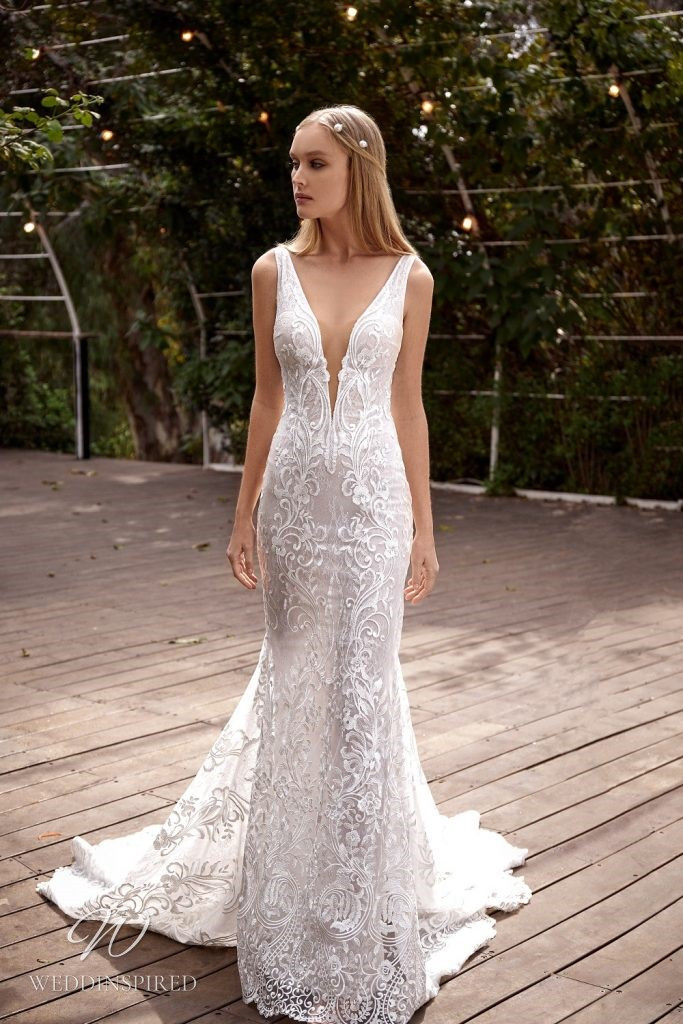 A Julie Vino 2021 lace mermaid wedding dress with a v neck and a train