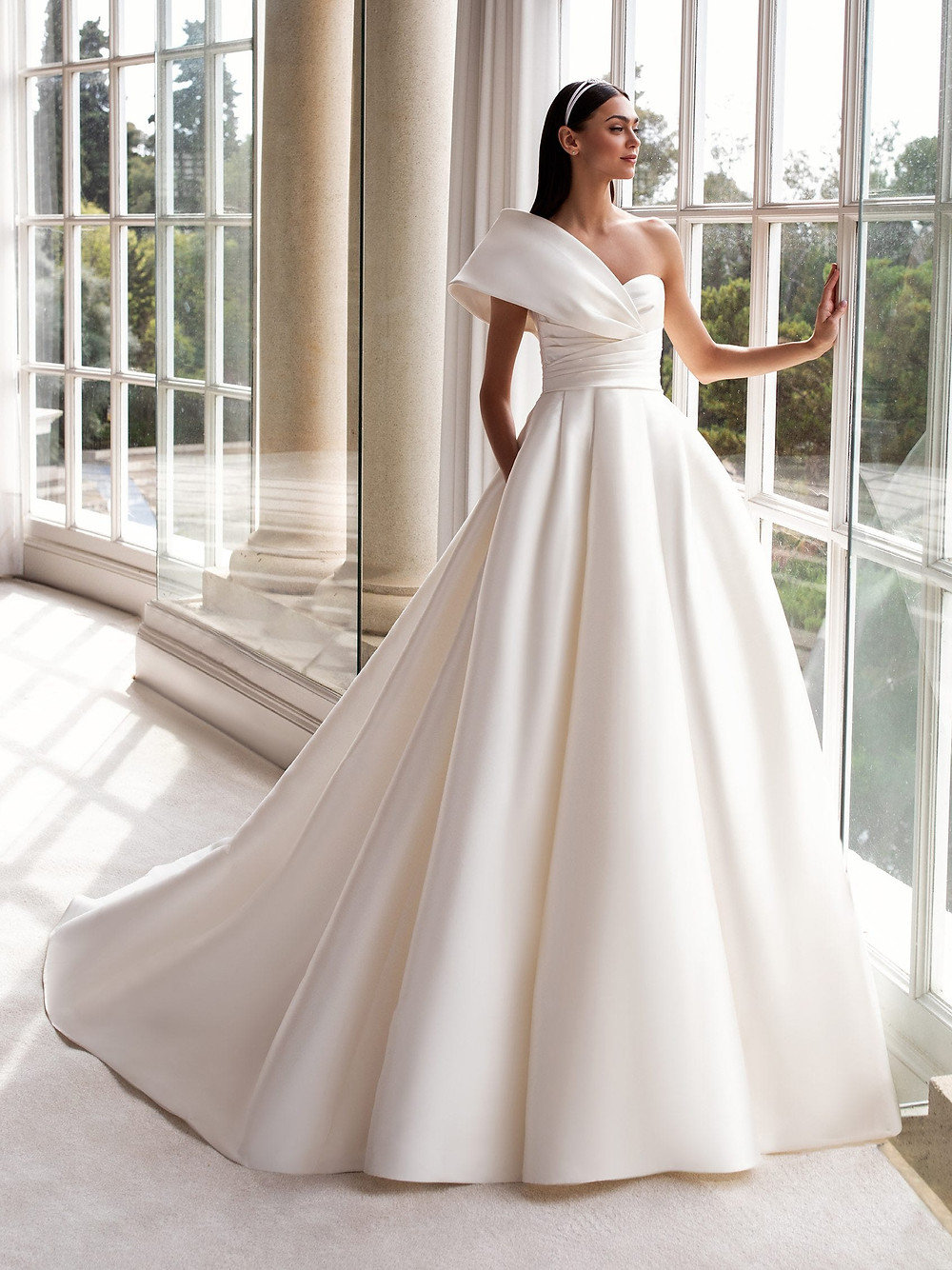 A one shoulder, ball gown wedding dress with large skirt