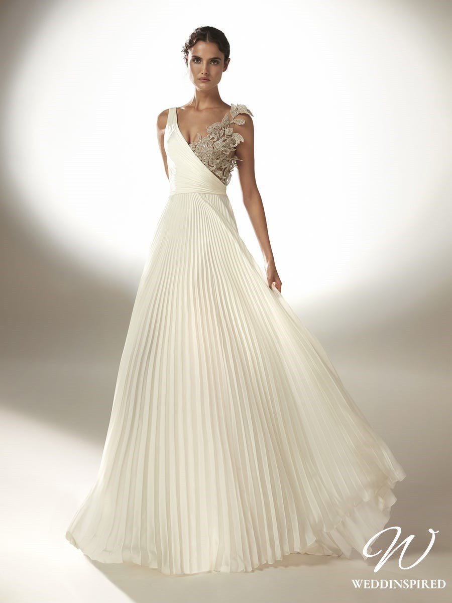 An Atelier Pronovias pleated A-line silk wedding dress with crystal embellishment