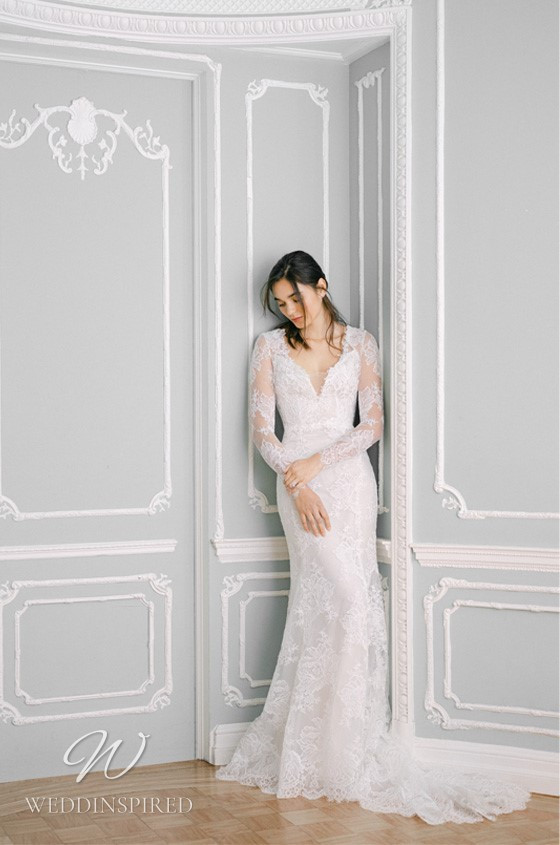 A Monique Lhuillier Fall 2021 lace mermaid wedding dress with long sleeves and a v neck