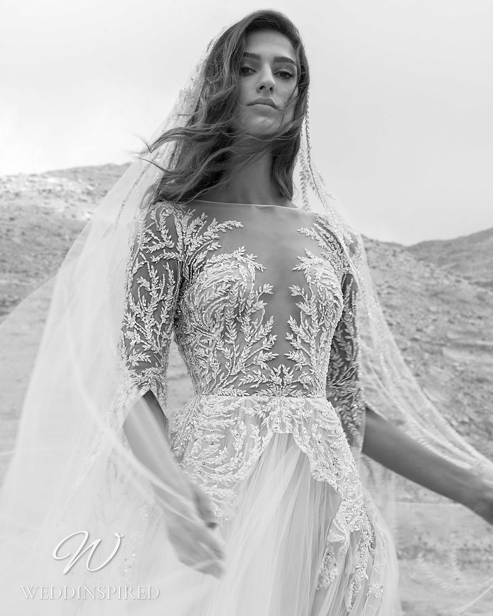 A Zuhair Murad Fall 2021 lace and tulle A-line wedding dress with long sleeves and an illusion neckline