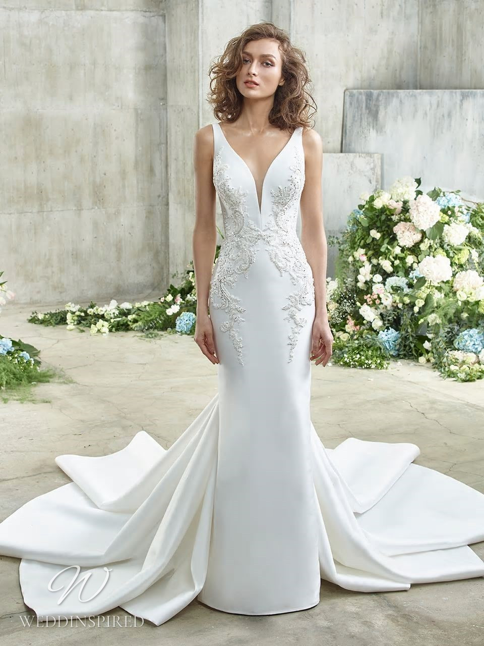 A Badgley Mischka silk mermaid wedding dress with a detachable skirt, embroidery and a v neckline