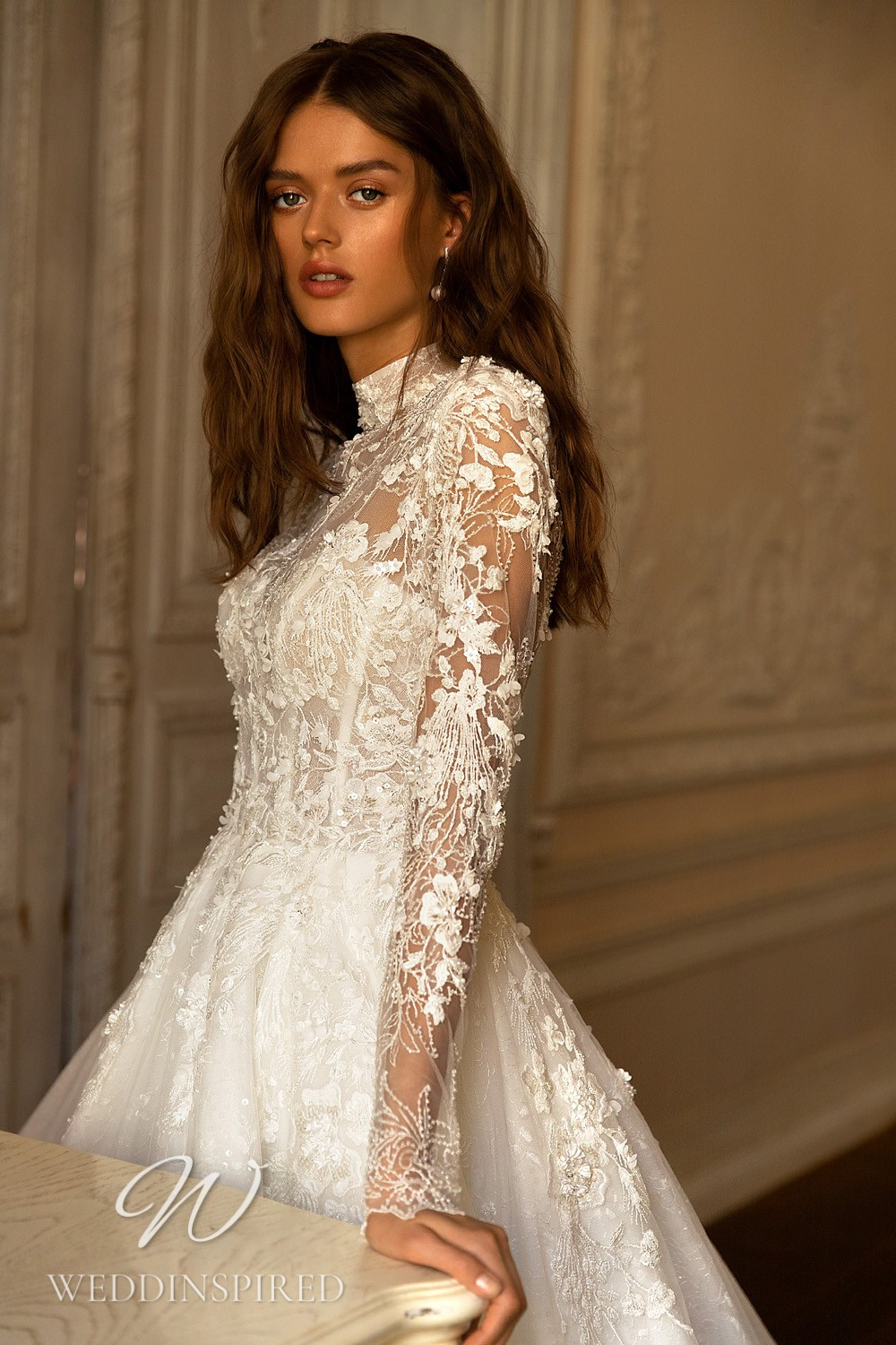 A WONÁ Concept 2021 lace A-line wedding dress with long sleeves