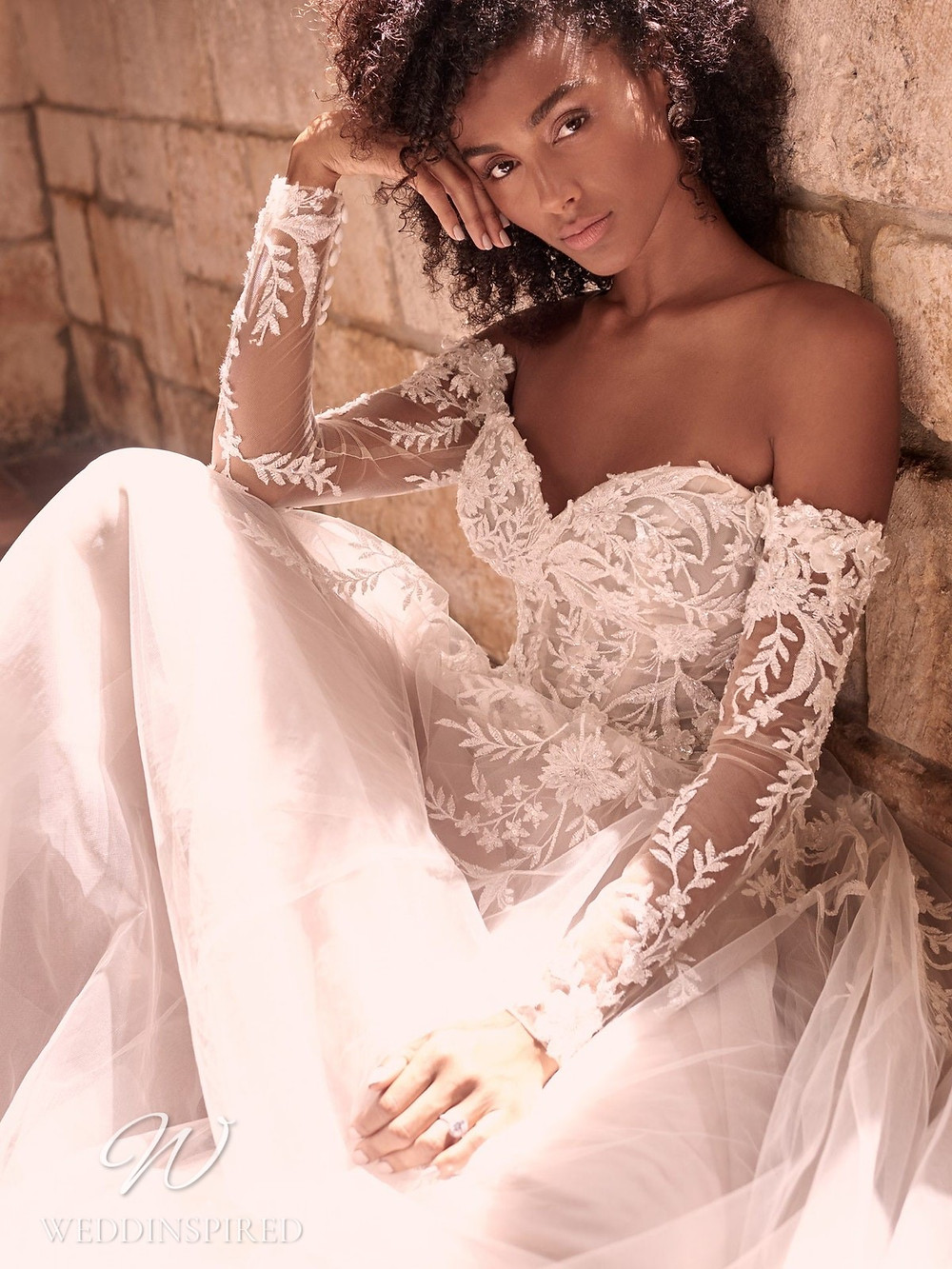 A Maggie Sottero Spring 2021 lace and tulle off the shoulder A-line wedding dress with long sleeves