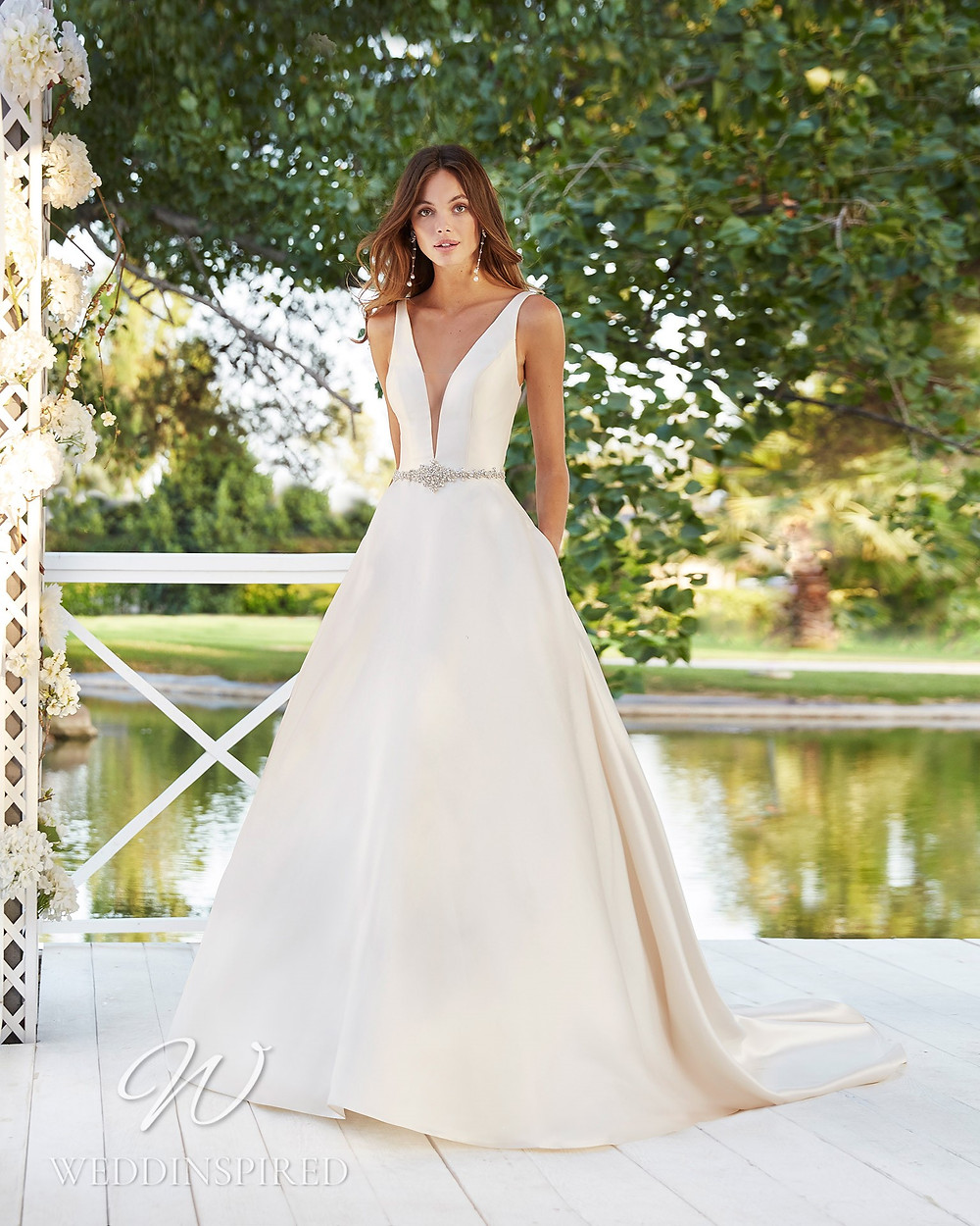 An Aire Barcelona 2021 simple satin A-line wedding dress with pockets