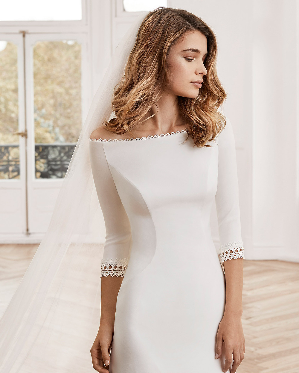 An Aire Barcelona 2020 off the shoulder crepe mermaid fit and flare wedding dress with half sleeves