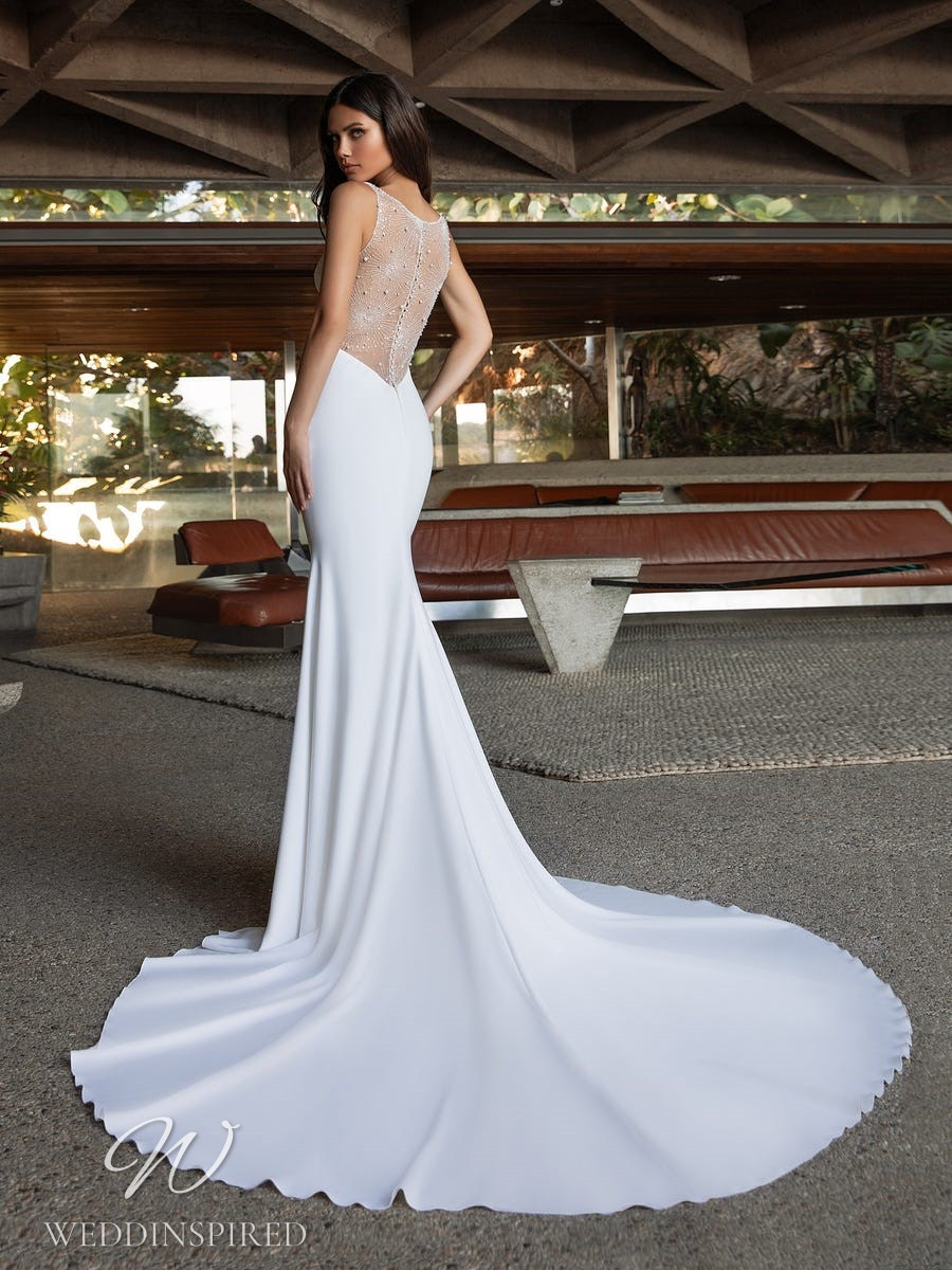 A Pronovias 2021 crepe mermaid wedding dress with a beaded illusion back