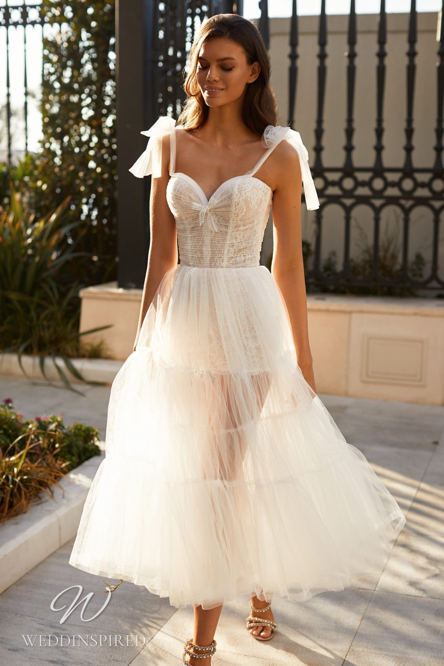 A Milla Nova 2021 lace and tulle tea length wedding dress with bow straps