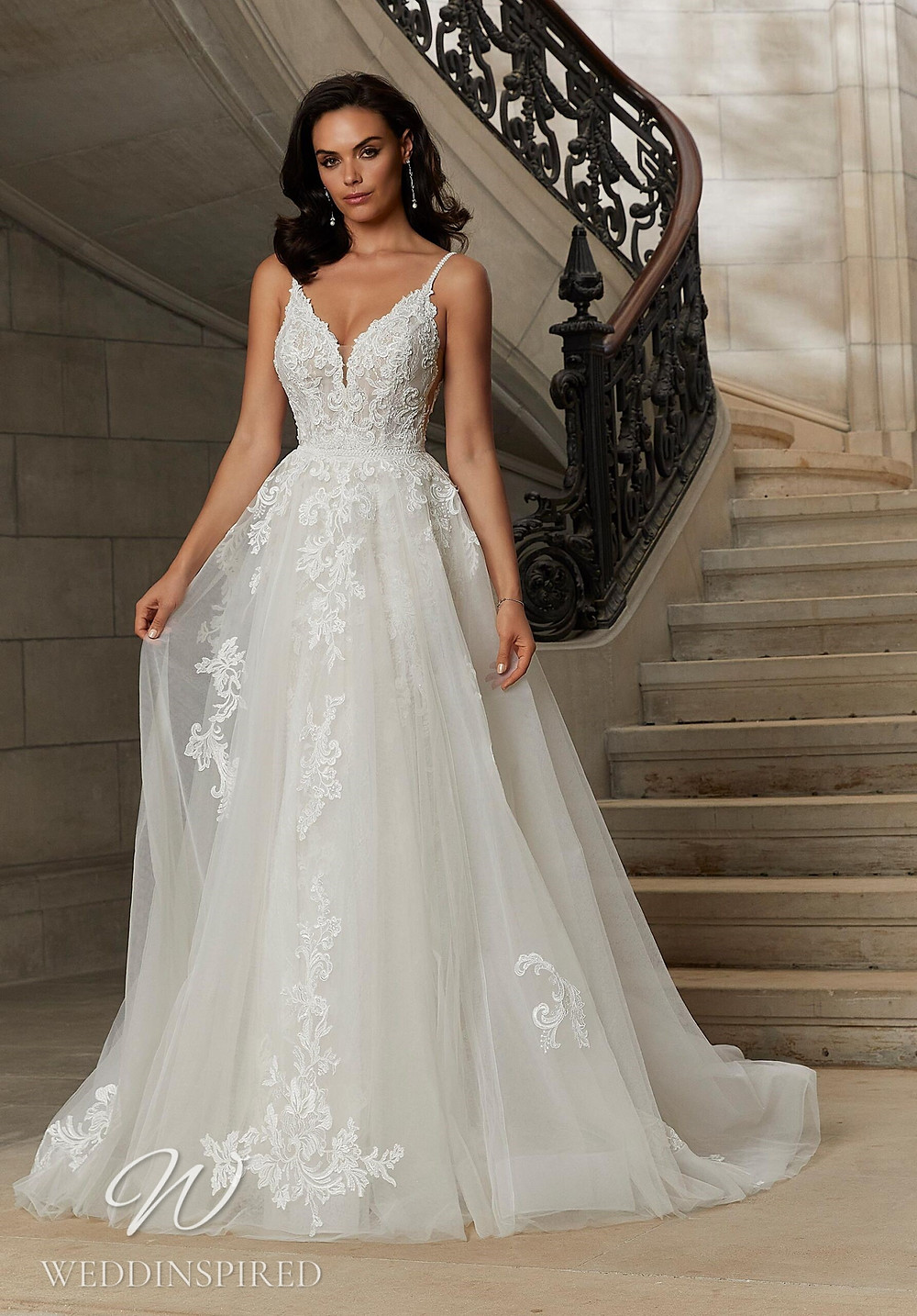 A Madeline Gardner lace and tulle A-line wedding dress with straps