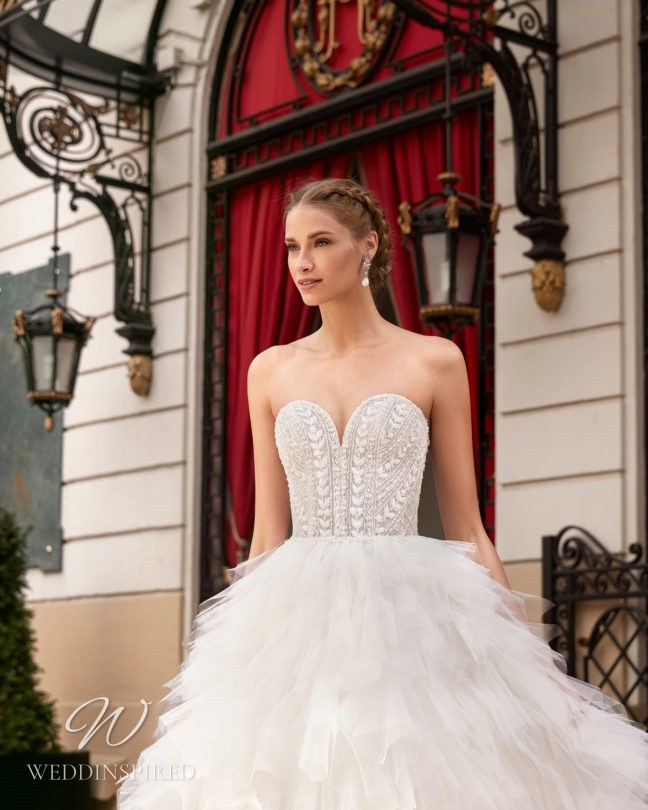 An Aire Barcelona 2021 strapless lace and tulle princess wedding dress with a layered ruffle skirt