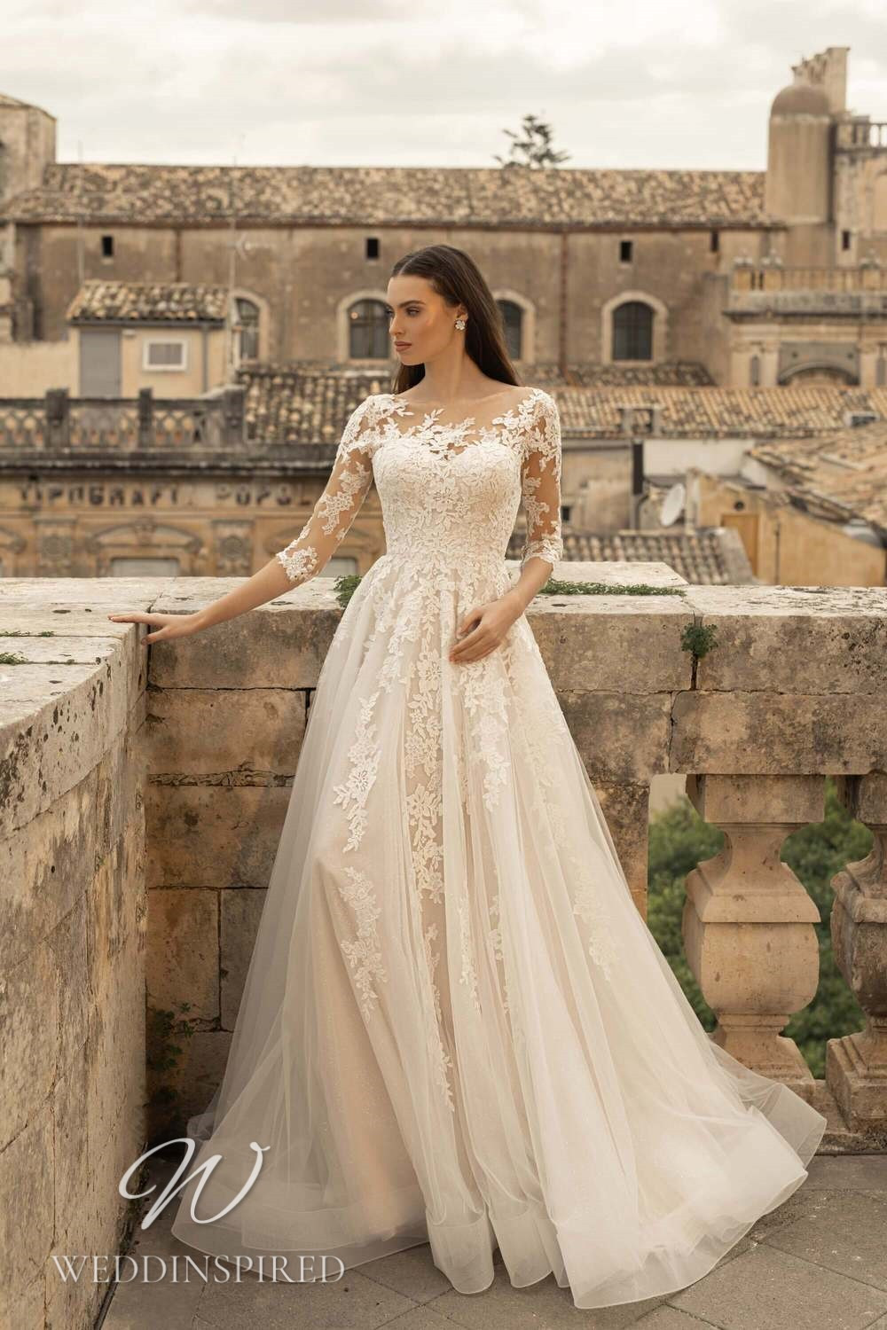 A Lussano 2021 ivory lace and tulle A-line wedding dress with half sleeves