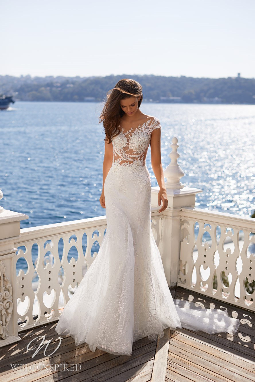 A Milla Nova 2021 lace off the shoulder mermaid wedding dress with an illusion bodice