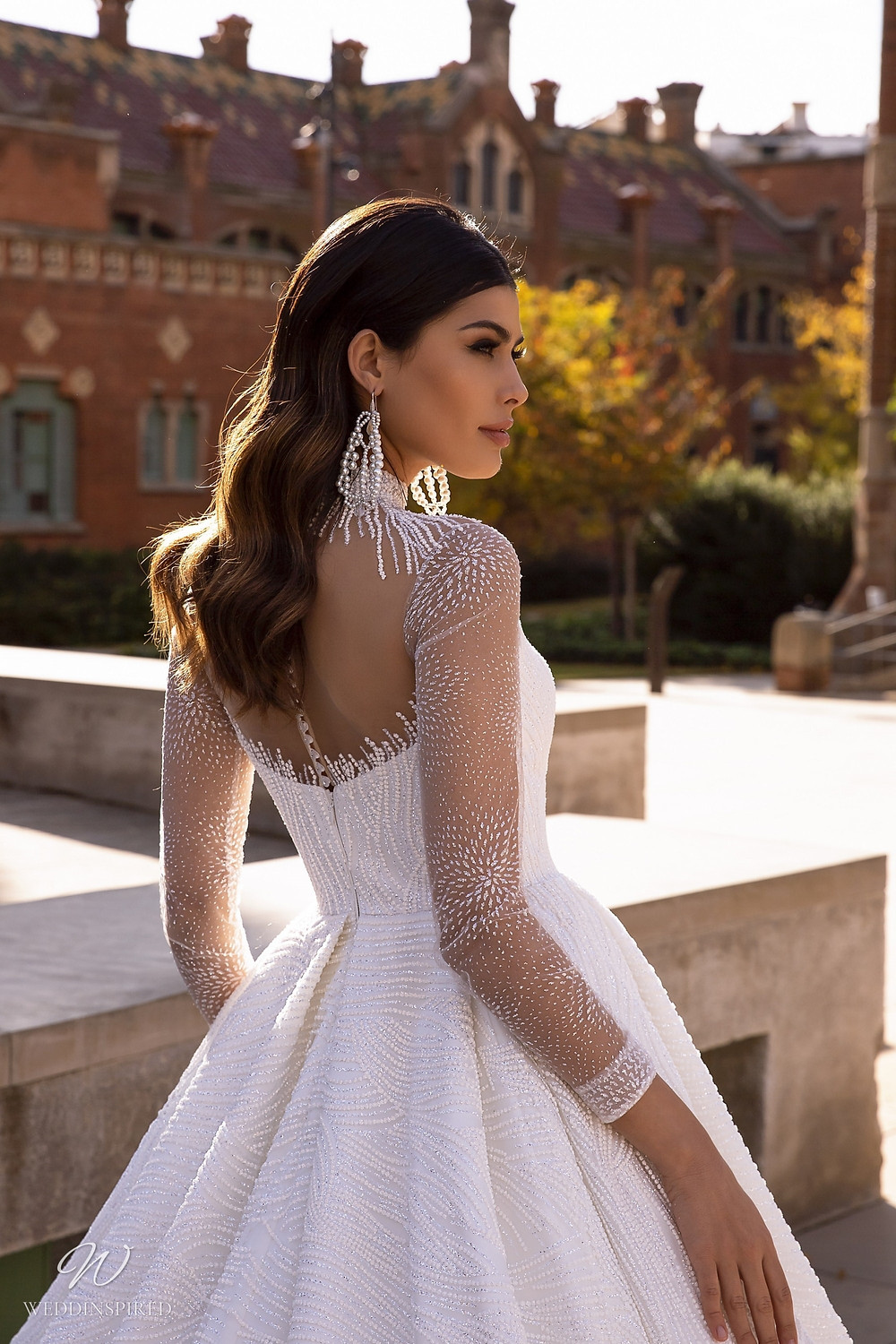 A Maks Mariano sparkle princess ball gown wedding dress with illusion top