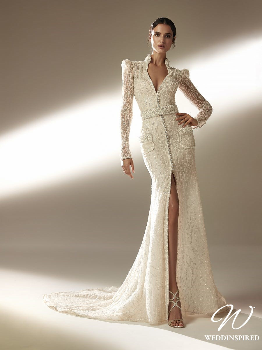 An Atelier Pronovias mermaid wedding dress with a low v neckline, long sleeves, beading and a train