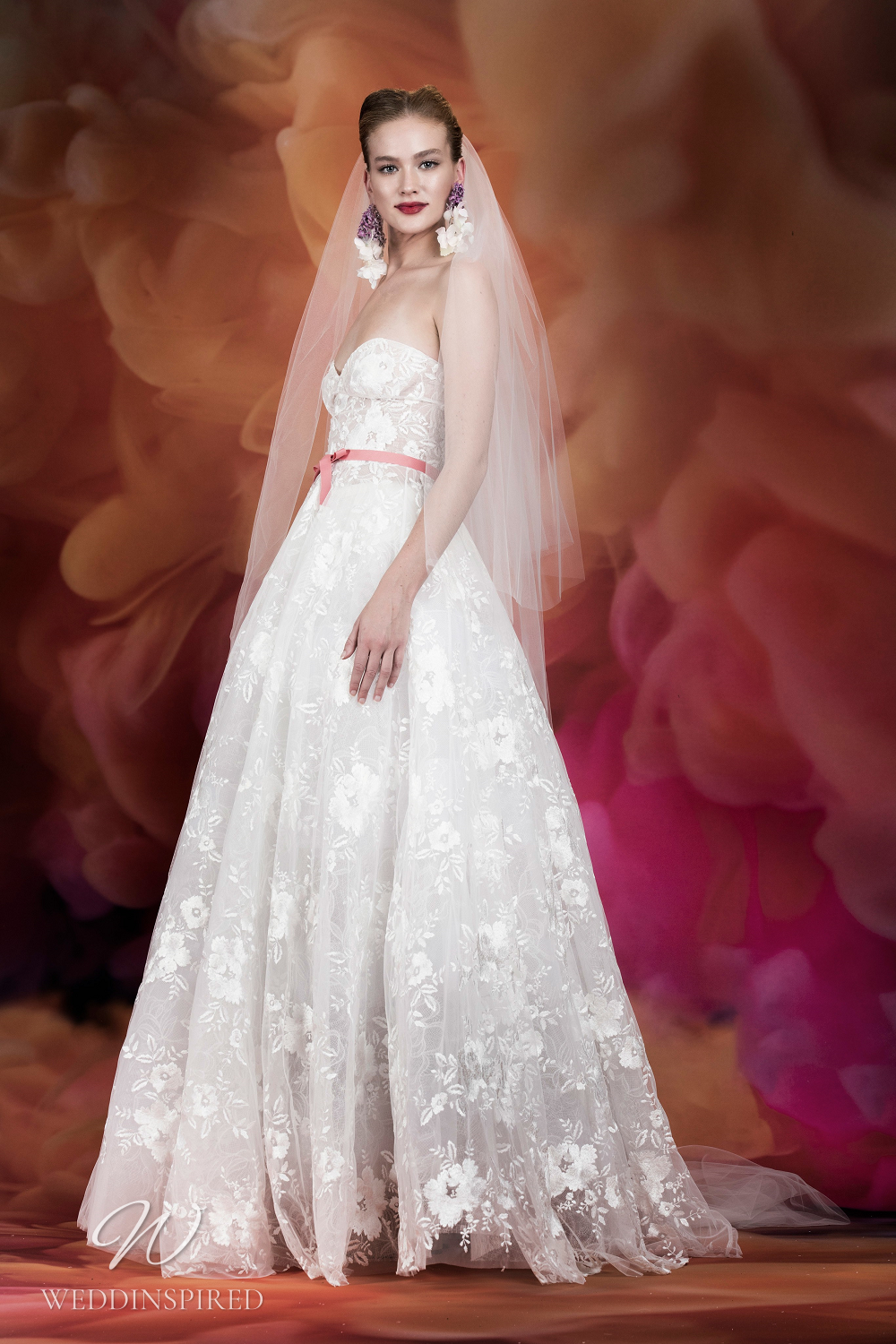A Naeem Khan lace princess ball gown wedding dress with a sweetheart neckline and a bustier top