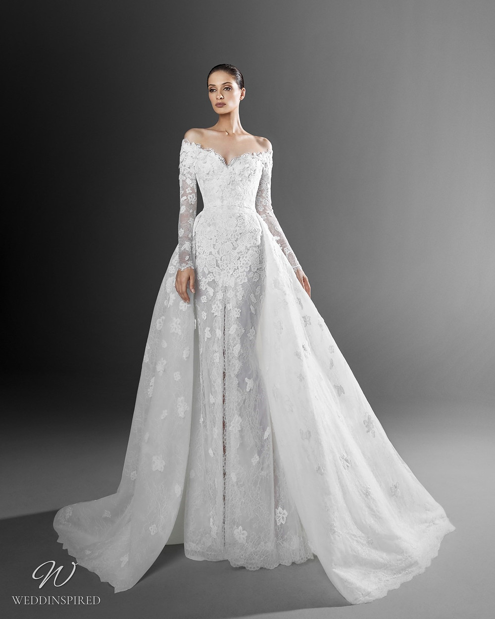 A Zuhair Murad mermaid off the shoulder wedding dress with lace, long sleeves and a detachable skirt