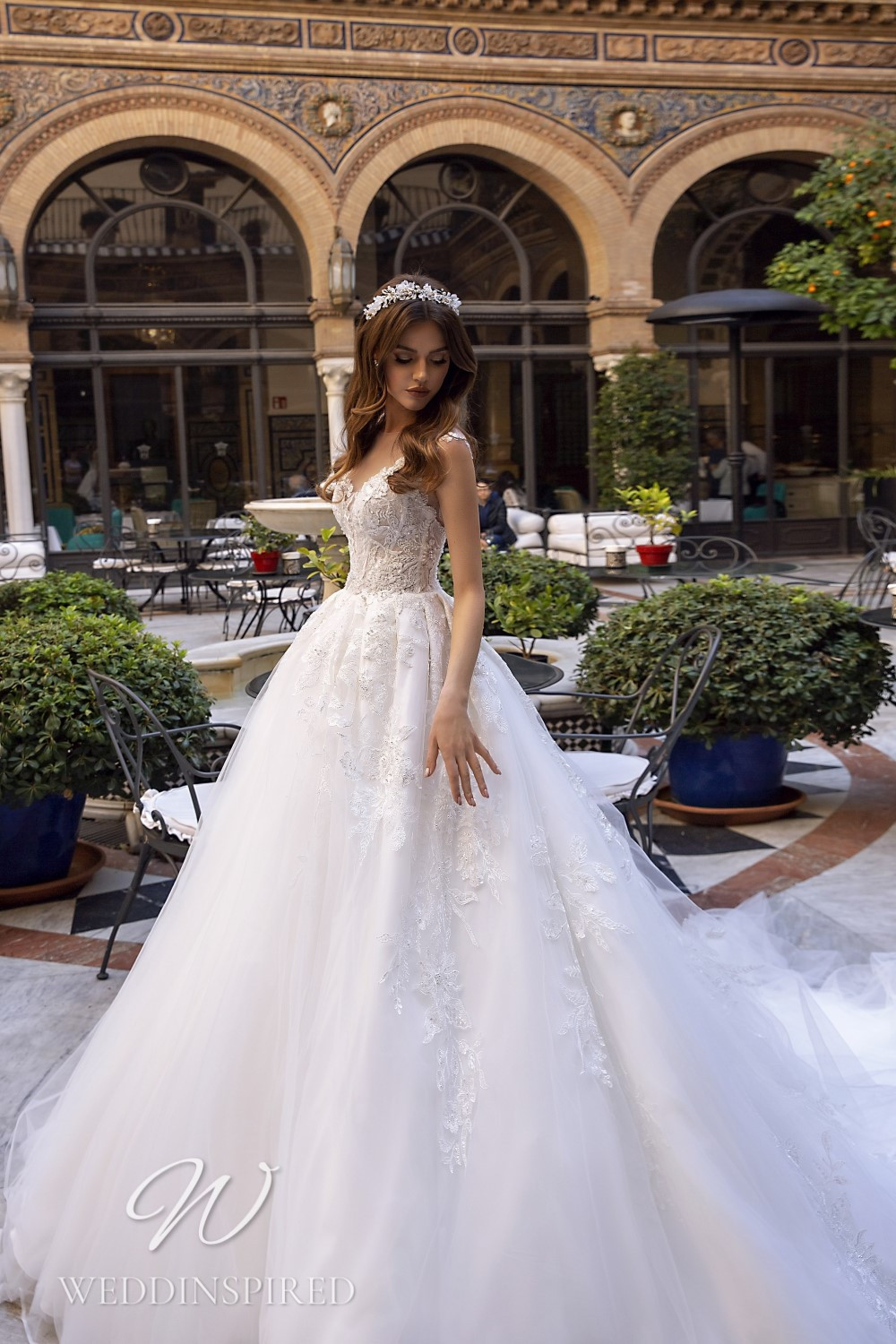 A Maks Mariano tulle and lace princess ball gown wedding dress