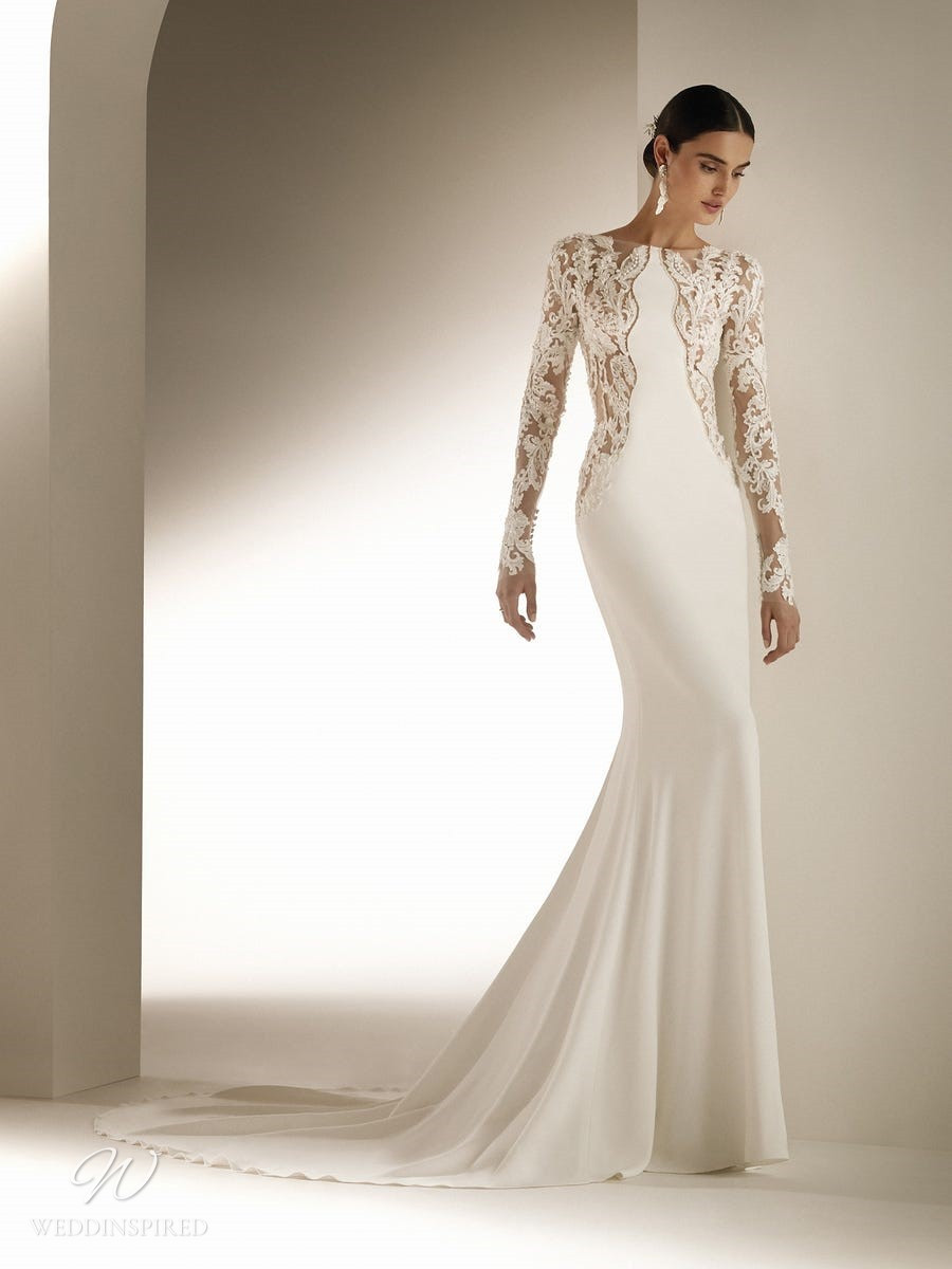 An Atelier Pronovias mermaid wedding dress with lace, long sleeves and a train