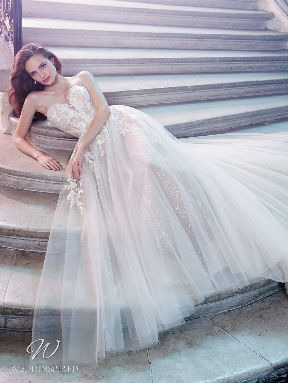 An Enzoani strapless lace and tulle princess ball gown wedding dress with a sweetheart neckline